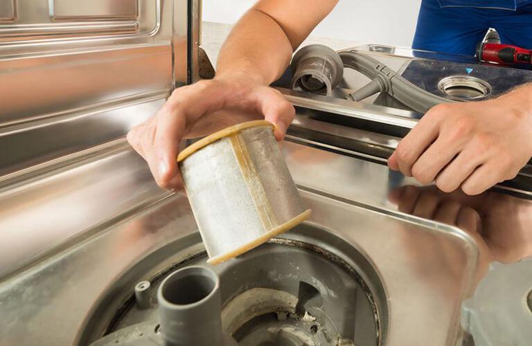 Man Repairing Dishwasher Parts