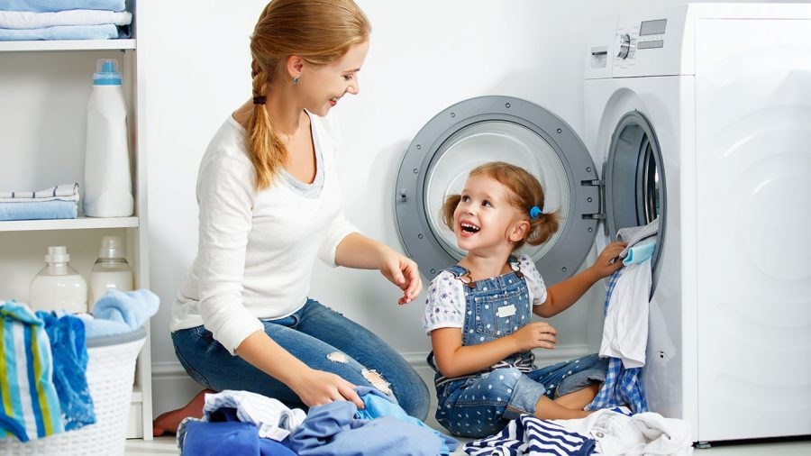 Mother & Daughter Doing Laundry
